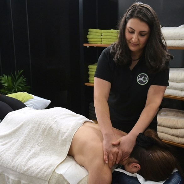 Dr Sofie performing an osteopathy treatment in Coburg Victoria.
