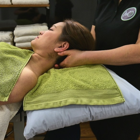 Osteopath of Moreland Osteopathy treating neck pain.